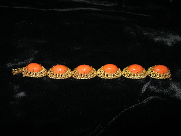 "Vintage  18KT solid gold fretwork bracelet with large coral cabachons. Coral cabachons measure 1/2""wide and 5/8"" long and are full domes. Beautiful Italian workmanship. Appraised 2/11 at $4,900 replacement. Our price, $3,295.00."